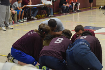 MSB boys team huddles on the playing floor