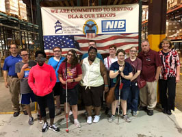 A group of students and staff pose for a photo during a tour at Lighthouse for the Blind St. Louis