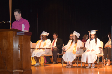 Graduates on stage for Commencement