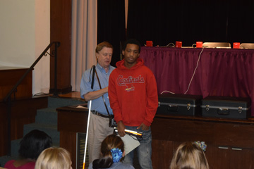Student Damon Tyson receiving Alma Murray Essay Contest award from Chris Gray of Missouri Council of the Blind