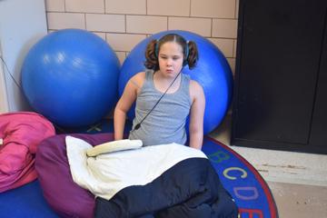 Kadence enjoys and audio book during leisure recreation