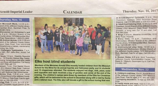 Newspaper clipping of photo and story regarded Meramc-Arnold Elks hosting MSB students for Haloween party