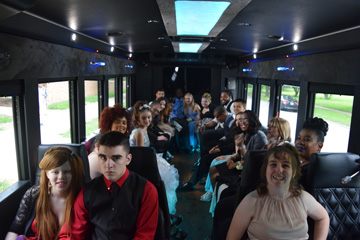 Prom attendees on the partybus limo