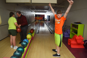 Camp abilities students in bowlign lessons