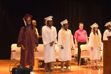 MSB graduates line up on stage during Commencement