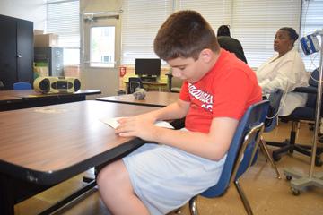 ESY students work on braille skills