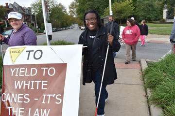 The MSB Mules march for White Cane Day, spreading awareness in the neghborhood