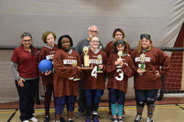 Group photo of MSB girls goalball team, coaches and administratotrs with their 2nd place trophy